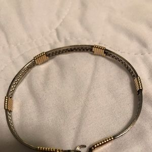 Silver colored and brass Artisan made bracelet.